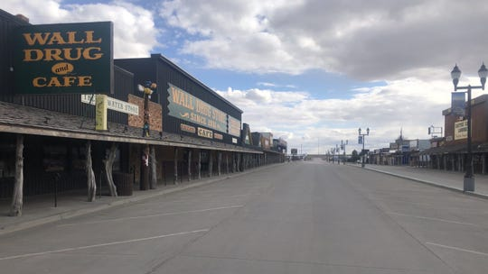 The usually busy street in front of Wall Drug was eerily devoid of people and cars on a 65-degree afternoon on Sunday, March 29 due to the COVID-19 pandemic. Wall Drug in Wall, S.D. and other tourist attractions have closed to slow the spread of the deadly virus.