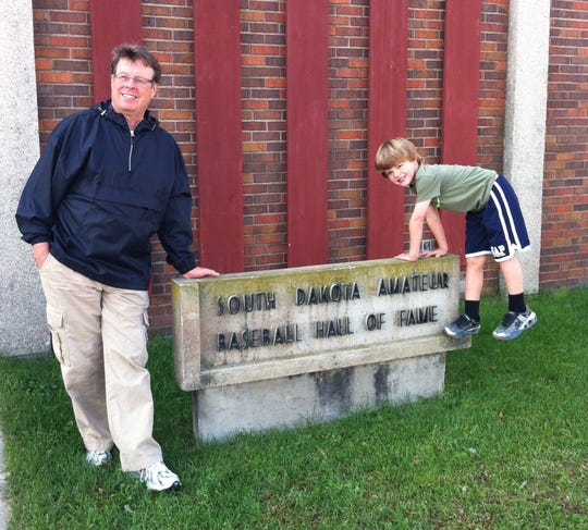 Mel Antonen with his son, Emmett, at the Amateur Baseball Hall of Fame in Lake Norden in 2012.