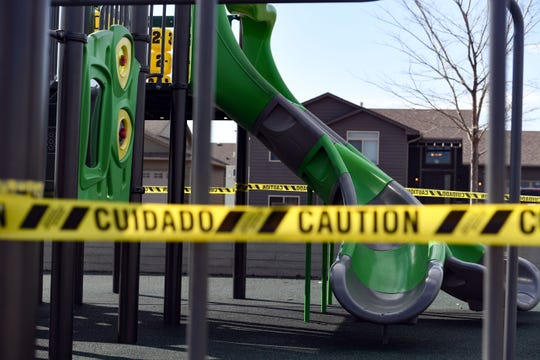 Playground equipment is closed off with caution tape to enforce social distancing on Wednesday, April 1, at Galway Park in Sioux Falls.