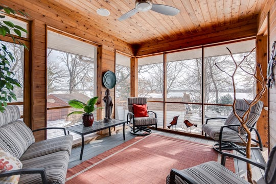 The porch is finished with cedar boards throughout and has floor-to-ceiling screen windows, a ceiling fan and ceiling speakers.