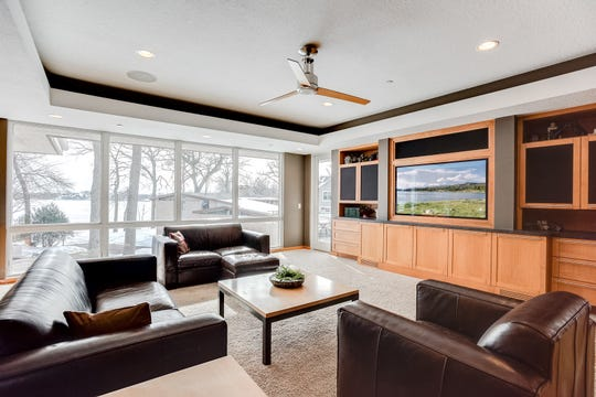 The living room faces lake-side with a full bank of picture windows.