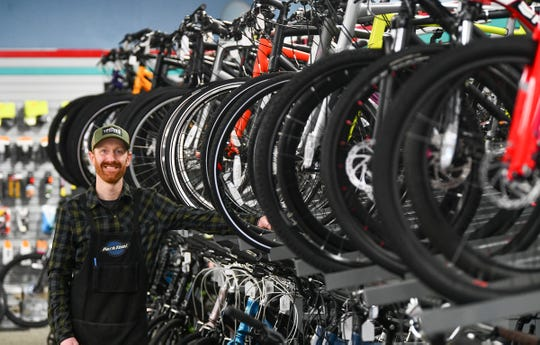 Mike Rathlisberger takes time from repairing bikes to pose for a photograph Wednesday, April 1, 2020, at  Fitzharris Ski, Bike and Outdoor in St. Cloud.