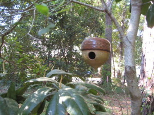 This homemade acorn shaped birdhouse is an example of how you can use this time to get creative in the garden.