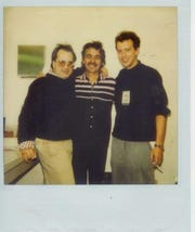 Matt Fuqua, left, John Prine,  and guest columnist Mark Hinson backstage at The Moon in 1987.