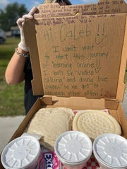 Jennifer Harris, a kindergarten teacher at West Gate K-8, wrote personalized messages in the pizza kits she delivered to her students during school closures.