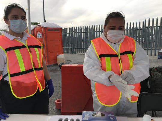 Chihuahua state paramedics work a checkpoint at the Bridge of the Americas in Juarez, where the state health department and state police were checking drivers for symptoms of coronavirus on Tuesday, March 31, 2020.