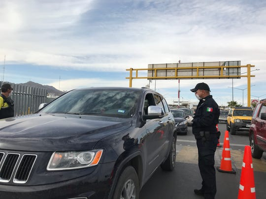 Chihuahua state police a checkpoint at the Bridge of the Americas in Juarez, where the state health department and police were checking drivers for symptoms of coronavirus on Tuesday, March 31, 2020.