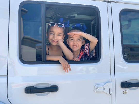 Bella Perez, left, and Lilli Perez went on a Teddy Bear hunt this week. El Pasoans can participate by placing teddy bears on their home windows for kids to find as they drive by.