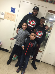 Omarion McKenzie's father and siblings. He was a superhero to his siblings, his aunt said.