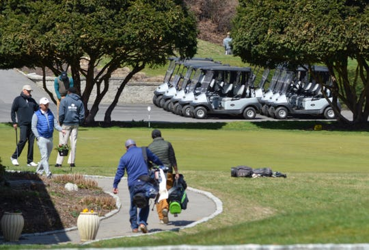 A fleet of sanitized carts sits at the ready outside the pro shop at Maple Moor Golf Course in White Plains on April 1, 2020. Guidelines put in place during the coronavirus pandemic limit riders to one per cart.