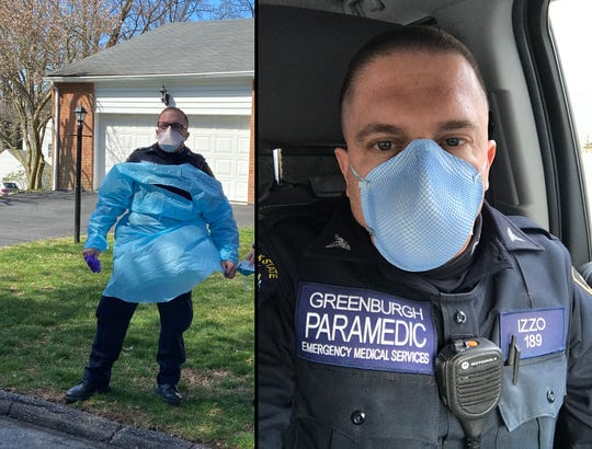 Donny Izzo, a paramedic with the Greenburgh Police Department's Emergency Medical Services, suits up in protective gear before entering a patient's home to protect himself from being exposed to the coronavirus.