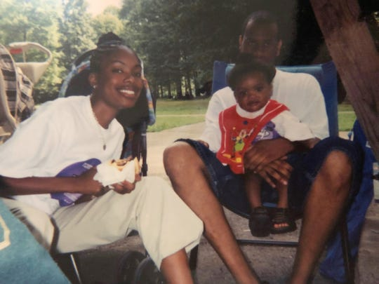 Omarion McKenzie as a young boy in his dad's arms and next to his mom.