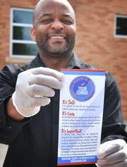 In this file photo, Chartwells K12 district manager Farai Sithole displays one of the bilingual Census 2020 reminder cards that was included in the Wichita Falls ISD school lunch distribution program while school-at-home was in session. Field operations are set to begin soon with COVID health safety measures in place.