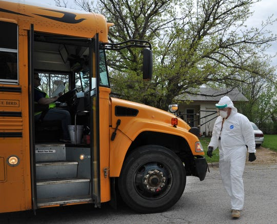Volunteers, riding in school buses, helped deliver educational materials to Wichita Falls Independent School District students as shown in this April 1, 2020, file photo. Wichita Falls ISD Superintendent has said the paper packets will likely be mailed instead to avoid stray dogs and locked gates.