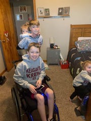 Keagan Meek was all smiles as he returned home Tuesday. He had been in Children's Hospital in Columbus, following a sledding accident in February. Submitted photo.