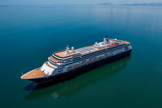 Aerial view of Holland America's cruise ship Zaandam as it entered the Panama City bay to be assisted by the Rotterdam cruise ship with supplies, personnel and COVID-19 testing devices, eight milles off the coast of Panama City, on March 27, 2020.