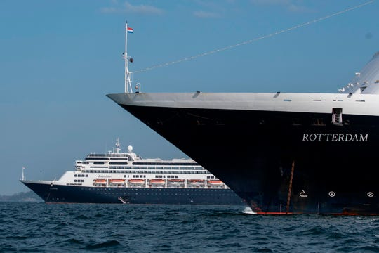 Holland America's MS Zaandam (left) was stranded at sea for the last two weeks of March after several South American ports refused to let it dock due to suspected cases of COVID-19 cases. Both the Zaandam and sister ship MS Rotterdam finally disembarked in Florida in early April.