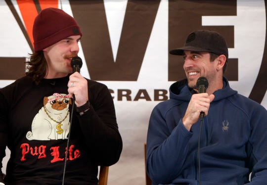 Green Bay Packers quarterback Aaron Rodgers (right) appears on Clubhouse Live on Dec. 10, 2012, at The Clubhouse Sports Pub & Grill in downtown Appleton. Then-Packers tight end Tom Crabtree (left) co-hosted the show.