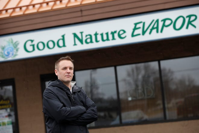 Benjamin Grothe, owner of Good Nature EVAPOR, stands outside his shop in Appleton on March 31, 2020.
