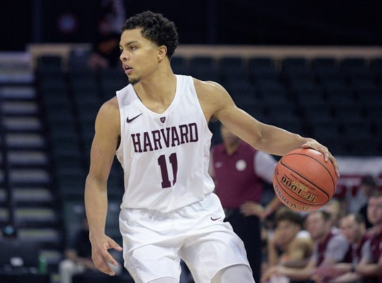 Harvard guard Bryce Aiken (11) sets up a play during the first half of an NCAA college basketball game against Maryland Friday, Nov. 29, 2019