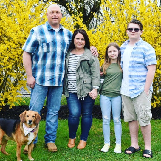 Jason and Linda Lisiewski of Cookstown and their children Charlotte, 10, and Carter, 13 - plus dog Shelby - pose for a family photo with photographer Stephanie Wolf.