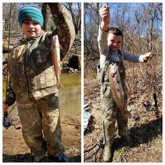 Scotty Roland, 8, (left) and Shane Roland, 5, both of Wall, with rainbow trout on Manasquan River on April 1.