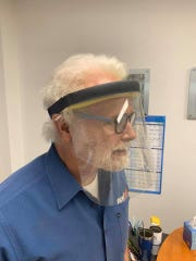 Charlie Pigeon, founder, owner and CEO of Tige Boats, models one of the face shields the Abilene-based boat manufacturing company will be making for first responders to protect against coronavirus COVID-19.