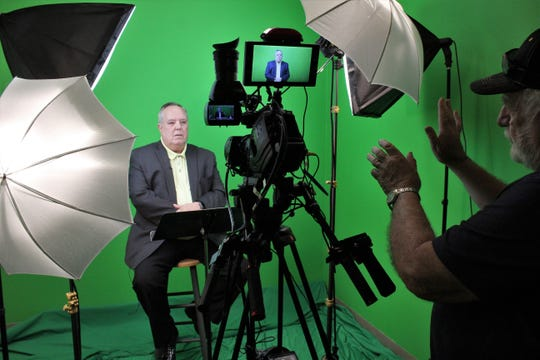 """Steve Patterson, pastor of St. Paul UMC, prepares to record his Holy Week lesson titled """"On the Road Again"""" on Thursday at First Baptist Church. Directing him is Doug Worthington."""