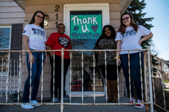 Family members Kandis Orns, Beatrice Orns, Kynadi Gray and Maddison Mahar from the Woolnough Street neighborhood created positive messages for Bronson Battle Creek Hospital staff, pictured on Thursday, April 2, 2020 at their home in Battle Creek, Mich.