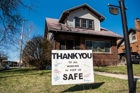 The Woolnough Street neighborhood of Battle Creek, Mich. creates positive messages for essential workers, pictured on Thursday, April 2, 2020.