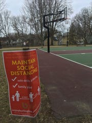 A sign in Pomeroy Park in Burlington's Old North End sets out rules for the basketball court during the COVID-19 pandemic, as shown on Thursday, April 2, 2020. Parks, Recreation and Waterfront announced it would be removing the hoops.