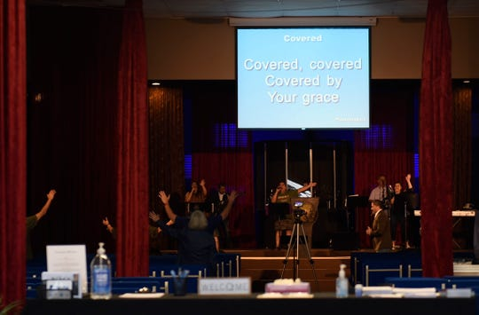 "Church attendees sing ""Covered, covered, covered by Your grace"", Wednesday, April 1, 2020, at The Bridge Church in Robstown. Gov. Greg Abbott declared on Tuesday that worship at religious institutions to be essential services, and that local authorities could not rule otherwise."