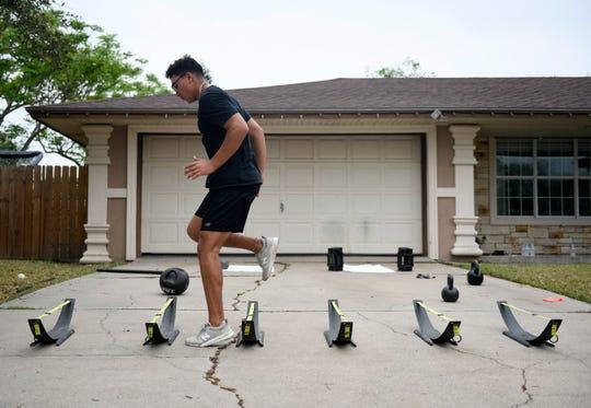 Orlando Salinas trains in his driveway, Saturday, March 28, 2020. Salinas plays baseball at King High School.