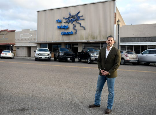 """Pastor Joel Garza stands outside his church, Wednesday, April 1, 2020, at The Bridge Church in Robstown. """"I believe it's the best place for us to be is at a church,"""" Garza says, """"we believe God shows up whenever we gather."""""""