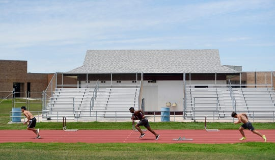 From left to right: Jerrick Gonzales, Julian Burnett and Season Henson train on the track, Tuesday, March 31, 2020, at Flour Bluff High School. Many senior athletes still continue to train during the social distancing precautions for coronavirus.