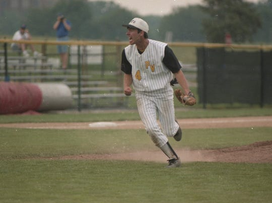 Paint Valley's Jason Stauffer celebrates after striking out Mariemont's Brad Buerger with the bases loaded and two outs in the final inning of the Bearcats' 9-7 state championship in 1995.