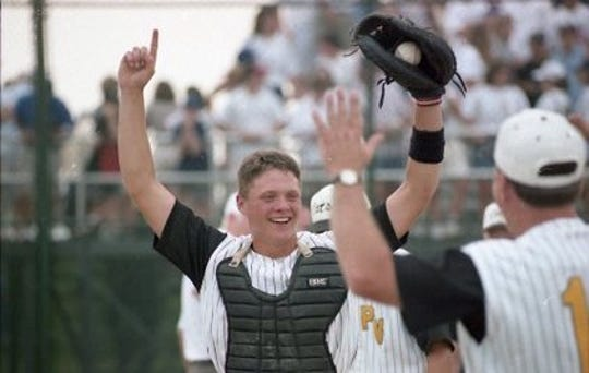 Paint Valley's Christian Newsome celebrates with teammates after the baseball team won the state championship in 1995. Newsome is holding the final game ball.