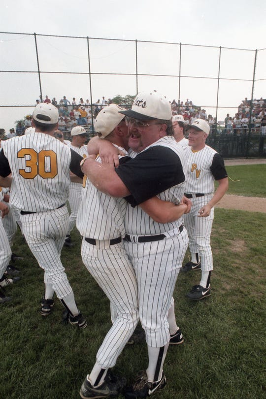 Coach Rod Gregory hugs one of his players after Paint Valley's baseball team won the state championship in 1995.