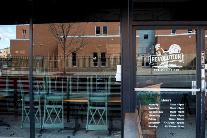 A view of the temporarily closed Revolution Rotisserie & Bar in Over-the-Rhine on Thursday, April 2, 2020.