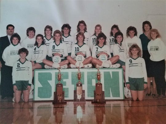 The 1986 Seton state championship team includes, from left: Standing, assistant coach Tony Esposito, manager Colleen Emmett, Katie Hieber, Sue Fishburn, Holly Herbst, Janet Haneberg, Stephanie Witte, Terry Bleh, Mgr. Colleen Murphy, Head Coach Mary Ritter, managerLisa Niederhausen; sitting, Heidi Hafner, Ann Fishburn, Julie Royer, Kathy Allen, Mary Keller; kneeling, Cheryl Drexler and Jenny Boerger.