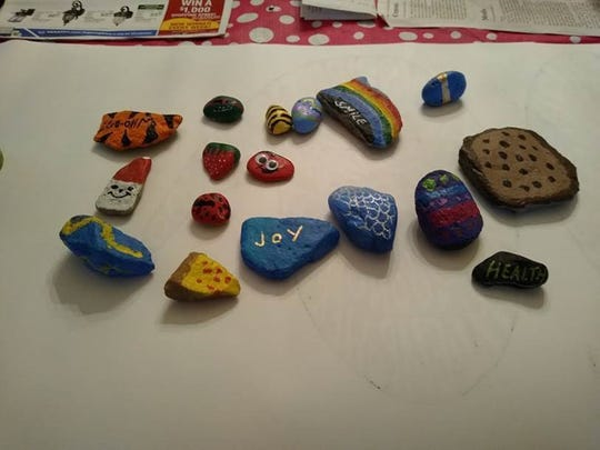 Rocks painted by 14-year-old Taylor High School student Mackenzie Carson. She drops them off with the Western Hills Press every Wednesday to customers and is hoping to spread some cheer during the novel coronavirus pandemic.