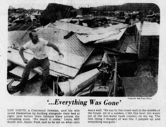 """April 3, 1974: '...Everything Was Gone' - Lou Loutz, a Cincinnati fireman, and his wife saved themselves by ducking alongside their bed at right, just before their furnace blew across the collapsing room. """"We heard it come,"""" Loutz, 6837 Sayler Ave., Sayler Park, said as he sat on what once was a wall. """"We ran by the closet wall in the middle of the house. All of a sudden, I felt this heat, hot water out of the hot-water tank (center) on my leg. The first thing I thought of was fire. I jumped up, and everything was gone."""""""
