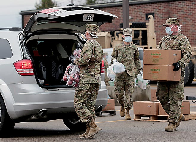 Members of the Ohio Army National Guard distributed boxes of food in Piqua from the Shared Harvest Foodbank. They will be distributing food boxes from 10 a.m. to noon, Saturday, from Fairfield Senior High School.