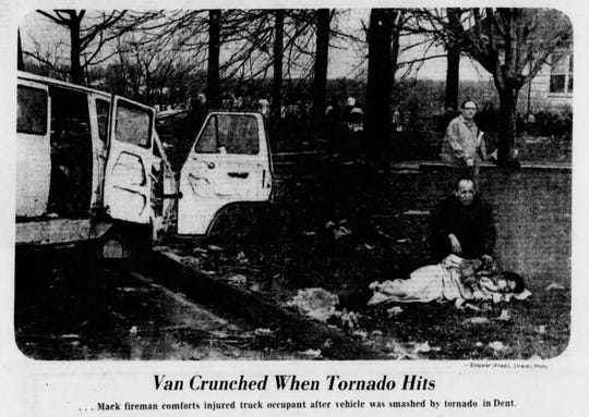 April 3, 1974: Van Crunched When Tornado Hits ... Mack fireman comforts injured truck occupant after vehicle was smashed by tornado in Dent.
