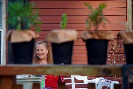 Teri Summers, a seventh-grade science teacher at Rossview Middle School, sits out on her porch to demonstrate how she uses Zoom to call her students and provide lessons even while school is out at the Summers' home in Clarksville, Tenn., on Wednesday, April 1, 2020.