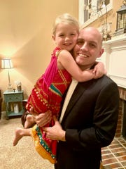 Kevin Kennedy Jr. smiles with his 4-year-old daughter, Kyla, after a daddy-daughter duet to raise money for Manna Cafe Ministries on March 28, 2020.