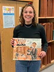 Hunterdon County Polytech Career & Technical High School student Molly Parsons holds the courtroom sketch that earned her second place in the New Jersey State Bar Foundation Courtroom Artist Contest.
