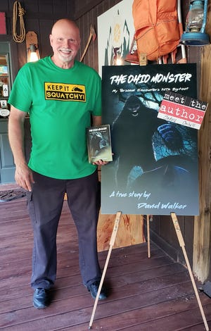"David Walker with a copy of his book, ""The Ohio Monster."""