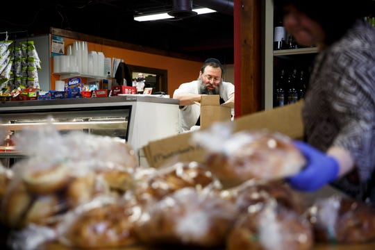 Rabbi Yossi Jacobson packs a box with groceries for Jeffery Cohen of Fairfield at Maccabee's Kosher Deli on Thursday, April 2, 2020, in Des Moines. The Cohen's make a monthly trip to the deli and grocery store, but called in this months order so they could maintain social distance rules.