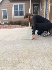 Ankeny junior sprinter Macey Filling used tape on her driveway to mimic a race starting line on March 26, 2020.